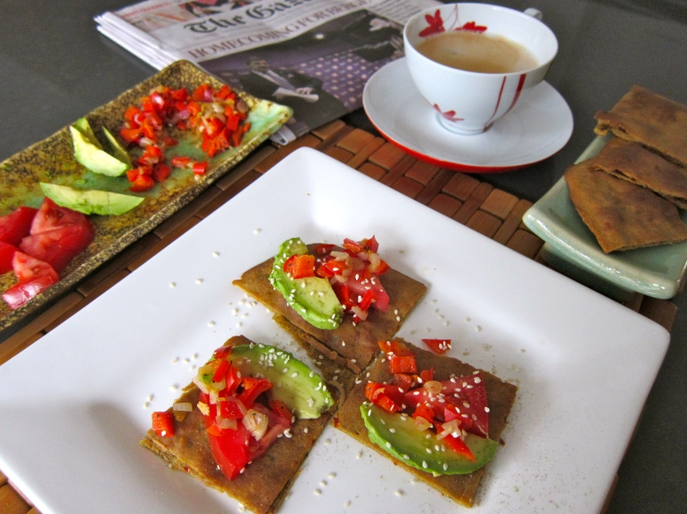 Baked Chickpea Flatbread - Socca with toppings: tomato, avocado, roasted red pepper and scallion